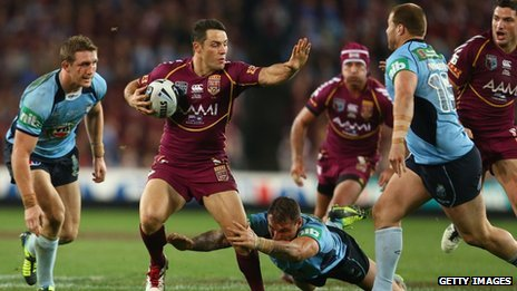 Cooper Cronk of the Maroons makes a break during game three of the ARL State of Origin series between the New South Wales Blues and the Queensland Maroons this year
