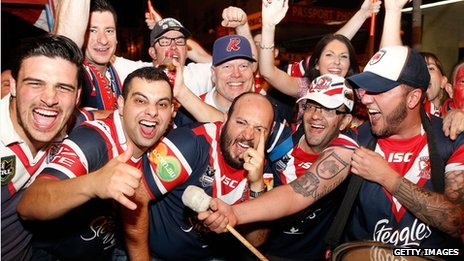 Sydney Roosters fans celebrate winning the 2013 NRL Grand Final