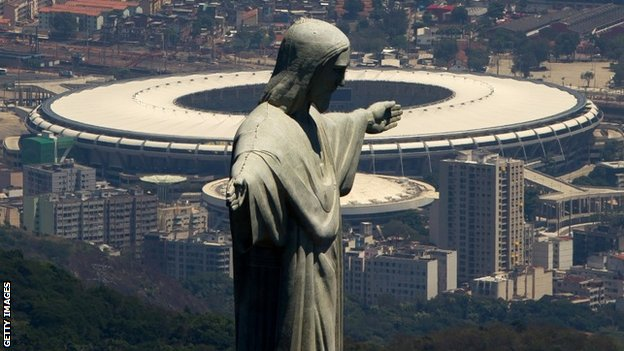 The Maracana stadium, with the Christ the Redeemer statue in the foreground