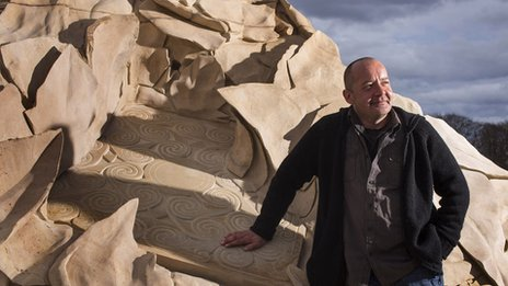 Barry Grove beside his Glenmorangie sculpture