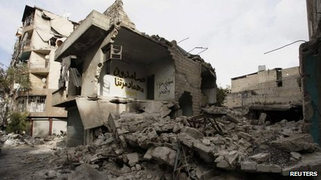 A house damaged by shelling is seen in Aleppo