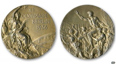 This handout provided by SCP Auctions, Inc shows the front, left, and back, right, of one of Jesse Owens four gold medals won at the 1936 Olympics in Berlin