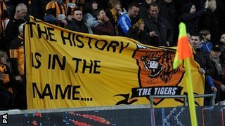 Hull fans display a banner during the win over Liverpool in support of the club staying as Hull City AFC