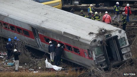 Emergency crews examined the Metro-North train derailment in the Bronx borough of New York on 2 December 2013