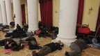Protesters rest at the Kiev city council building which they occupied  (02/12/21013)