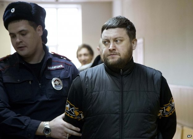 Yuri Zarutsky is led into court in Moscow, 3 December
