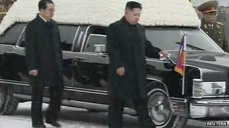 Kim Jong-un and his uncle Chang Song-thaek (L) accompany the hearse carrying the coffin of late North Korean leader Kim Jong-il during his funeral procession in Pyongyang on 28 December 2011