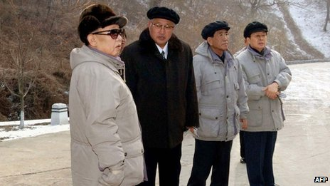This undated file picture released by North Korea's official Korean Central News Agency (KCNA) on 18 January 2009 shows North Korean leader Kim Jong-Il (L) inspecting the Mt Ryongak Recreation Ground in Pyongyang with Chang Song-thaek (R)