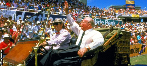 Sir Donald Bradman waves to the crowd during a lap of honour at the Bicentennial Test in 1988