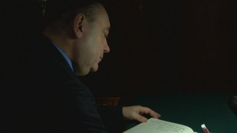 Alex Salmond signs the book of condolence