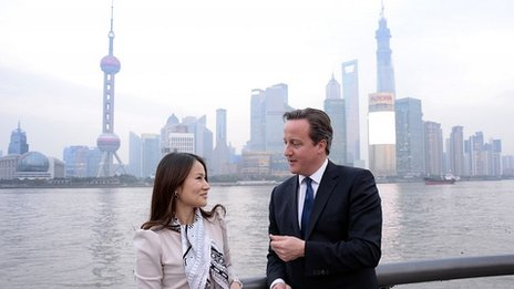 "Prime Minister David Cameron walks along The Bund in Shanghai with Lisa Pan, Vice President of Rekoo, one of Asia""s largest social gaming companies,"