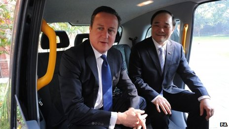 Prime Minister David Cameron sits in a London black cab with Geely Chairman Li Shufu who intends to operate London taxis in Shanghai.