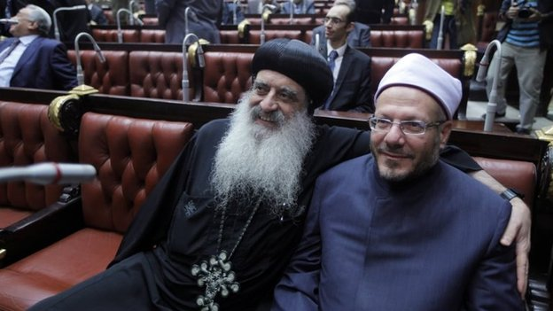 A representative of the Coptic Orthodox Church, Bishop Bola (left) and Egypt's Grand Mufti Shawqi Allam (right) inside the Shura Council (30 November 2013)