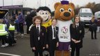 School Reporters Frankie (left), Lucy (centre) and Charlotte (right) with Football Association Women's Super League mascot Berry the Bear (right) and his Burton Albion counterpart Billy Brewer