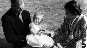 A baby Prince Charles with his parent in 1949