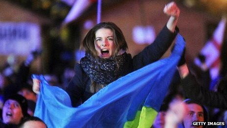 A protester holds a Ukrainian flag during an opposition rally on December 3, 2013.