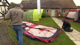 Man putting up tents