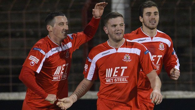 Darren Murray (centre) is congratulated after scoring Portadown's second goal at the Oval