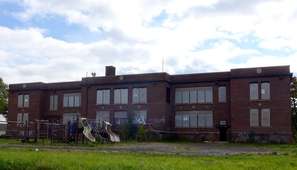 Abandoned school with playground