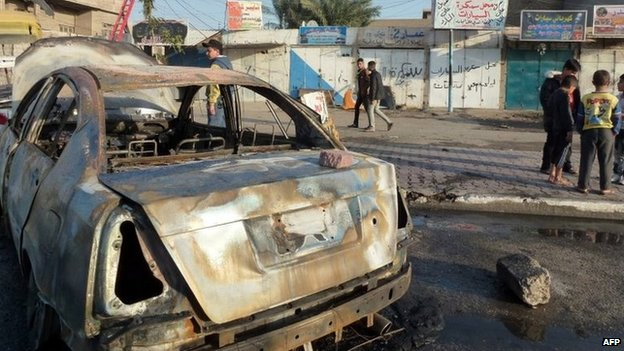 Aftermath of car bombing in Baiyaa, Baghdad (3 December 2013)