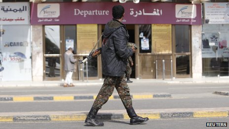 A police trooper walks outside the departure lounge Sanaa International Airport on 7 August 2013