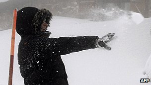 A boy throwing a snowball