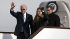 US Vice-President Joe Biden waves as he walks out of Air Force Two with his granddaughter, Finnegan Biden (centre) and son Hunter Biden (right) upon their arrival in Beijing on 4 December 2013