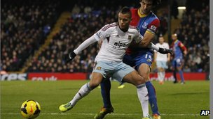 Crystal Palace's Mile Jedinak, right, tussles with West Ham United's Ravel Morrison