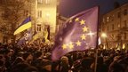 People attend a rally held by supporters of EU integration near the presidential administration building in Kiev