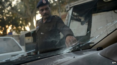A Pakistani policeman examines Mr Jalbani's bullet-riddled vehicle