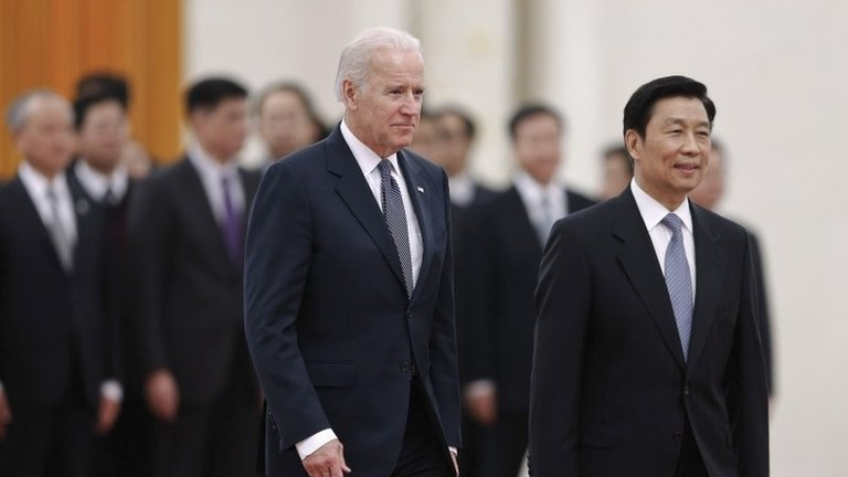 Chinese Vice President Li Yuanchao (2nd L) accompanies U.S. Vice President Joe Biden