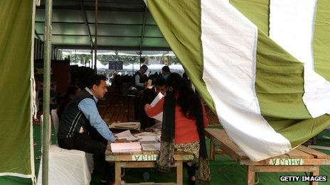 Officials look at documents in a polling station