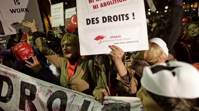 Sex workers attend a protest demonstration after French deputies voted for a reform of prostitution law in Paris December 4, 2013