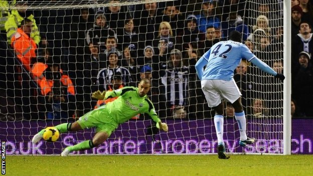 Yaya Toure scores Manchester City's third goal from the spot