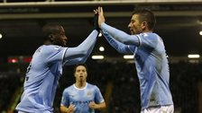 Yaya Toure celebrates his goal for Manchester City with Aleksandar Kolarov
