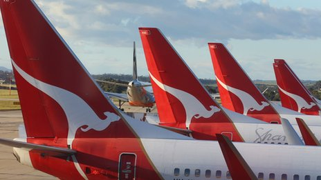 Qantas issues profit warning...