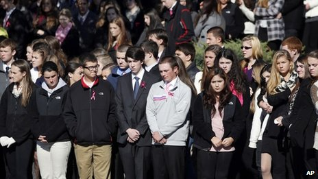 Students and other mourners line the sidewalk to watch as the funeral procession of slain Danvers High School teacher Colleen Ritzer begins to move from St Augustine Church in Andover, Massachusetts 28 October 2013