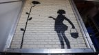 Banksy work Flower Girl