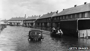 Great flood of 1953: Residents being rescued from flooded street, Canvey Island, Essex