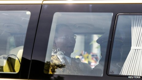 Thailand's King Bhumibol Adulyadej (L) and Crown Prince Maha Vajiralongkorn (R) arrive in a van at Klai Kangwon Palace, Hua Hin, Prachuap Khiri Khan province, 5 December 2013