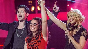 Andrea Begley stands with an arm in the air next to Danny O'Donoghue and Holly Willoughby after winning The Voice.