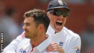 James Anderson is congratulated by Graeme Swann