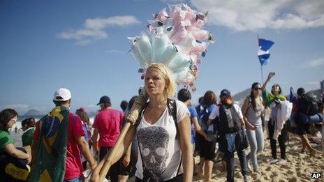 A food vendor on Rio's Copacabana beach selling cotton candy