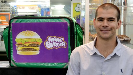 Raphael Kras, from Hareburger, poses at his Ipanema store