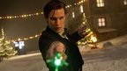 Matt Smith as the Doctor pointing his glowing green sonic screwdriver at the camera.