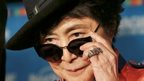 Yoko Ono adjusts her sunglasses as she speaks in Tokyo during a campaign to fight childhood hunger around the world