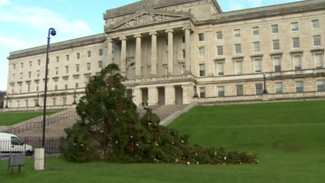A tree decorated for Christmas broken by the wind outside Stormont, Northern Ireland
