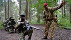 Corporal Andy Smith instructs Kenya Wildlife and Forest Services rangers