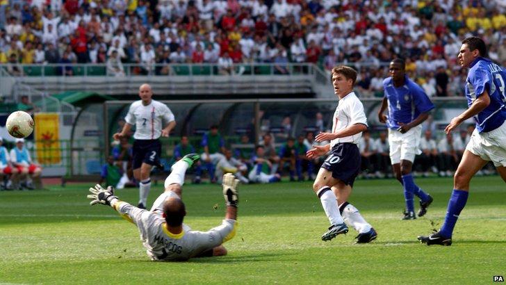 Michael Owen scores against Brazil in 2002