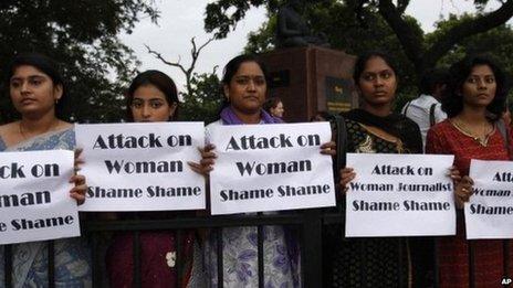 Women protest against the gang rape of a photojournalist in Mumbai